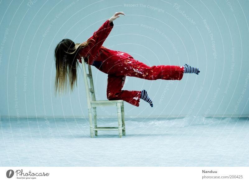 Position 3: Fliegen ist schön. Mensch rot feminin fliegen Stuhl skurril sportlich Schweben Fleck Surrealismus Yoga Möbel scheckig Arbeitsanzug Sitzgelegenheit