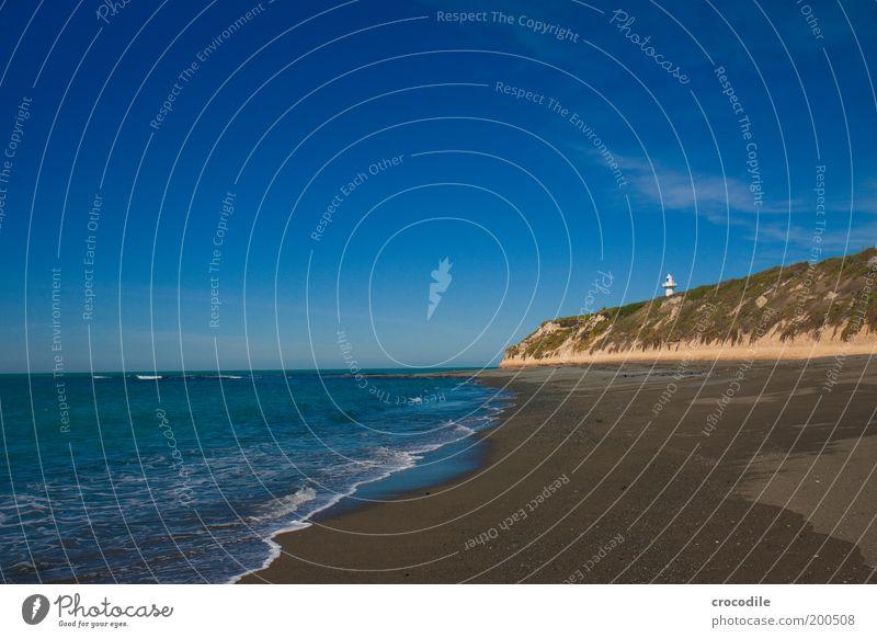 New Zealand 64 Umwelt Natur Landschaft Erde Sand Wasser Wolken Schönes Wetter Sträucher Hügel Felsen Wellen Küste Strand Meer Insel Neuseeland Leuchtturm