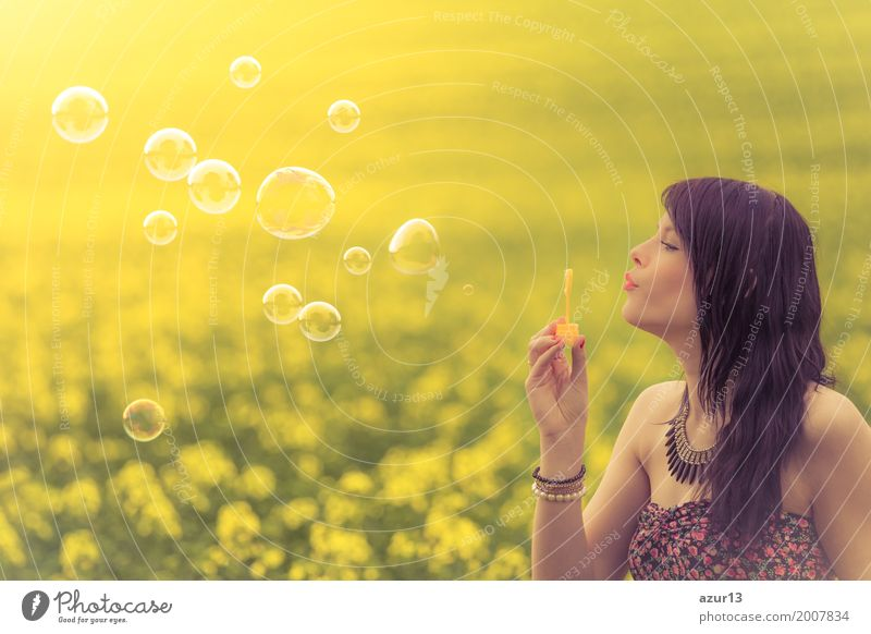 Beautiful woman blowing funny soap bubbles in summer nature Mensch Frau Natur Ferien & Urlaub & Reisen Jugendliche Pflanze Sommer schön Sonne Landschaft Blume