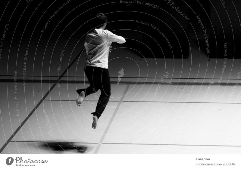 tanzend Freude Leben Tanzen Sport Mensch maskulin Junger Mann Jugendliche 1 18-30 Jahre Erwachsene Bewegung fliegen springen ästhetisch dunkel elegant schwarz