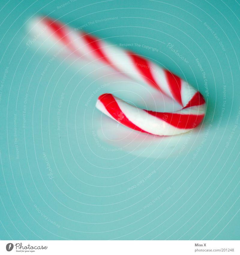 Zuckerstange blau weiß rot Lebensmittel Ernährung Dekoration & Verzierung süß Süßwaren lecker gestreift hart Zucker ungesund Textfreiraum links Zuckerstange