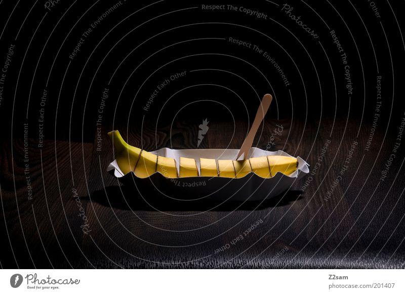 bio currywurst Frucht Ernährung Fastfood Gesundheit Holz stehen ästhetisch dunkel lecker gelb schwarz elegant Idee nachhaltig Qualität skurril Banane Currywurst