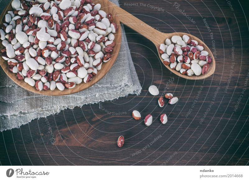 Rote weiße Bohnen in einer hölzernen Schüssel und in einem Löffel Gemüse Frucht Ernährung Essen Vegetarische Ernährung Diät Schalen & Schüsseln Holz frisch