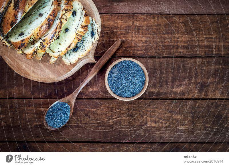 Mohn in einer Holzschale und einem Löffel schwarz Essen braun Ernährung frisch Kräuter & Gewürze Dessert Schalen & Schüsseln Brötchen Essen zubereiten roh
