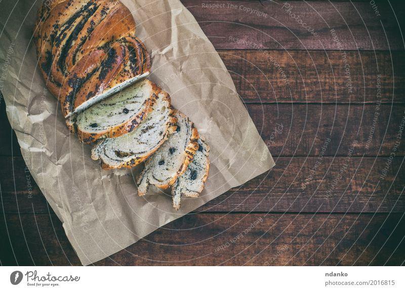 Brötchen mit Mohn auf Kraftpapier schwarz Holz braun oben Ernährung frisch Tisch Papier lecker Frühstück Dessert Brot Backwaren Abendessen Mahlzeit