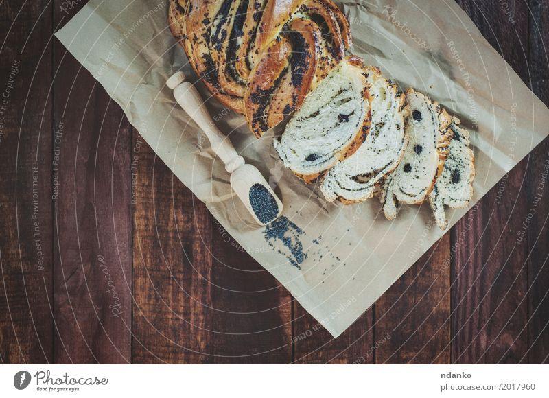 Gebackenes Gebäck mit Mohn Lebensmittel Brötchen Dessert Kräuter & Gewürze Ernährung Löffel Holz Essen frisch natürlich braun schwarz Haufen süß organisch