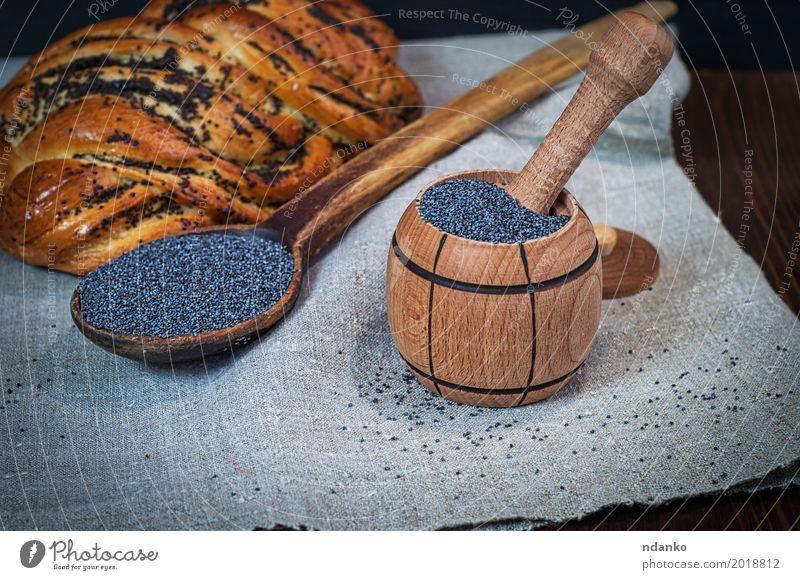 Mohn in einem hölzernen Mörser Brötchen Dessert Kräuter & Gewürze Ernährung Schalen & Schüsseln Löffel Holz frisch natürlich braun schwarz Gebäck Haufen Korn