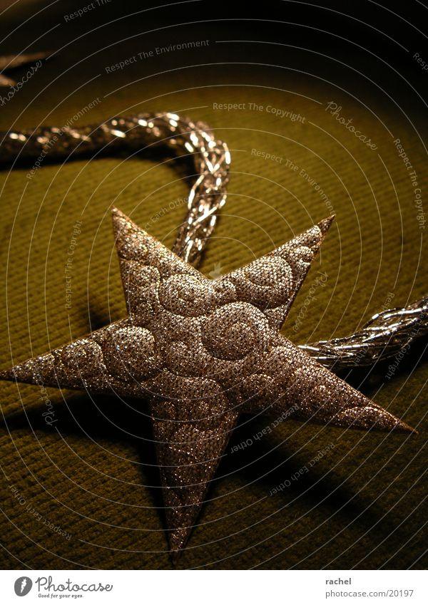 stern an der leine Weihnachten & Advent dunkel Stimmung Feste & Feiern Stern glänzend Stern (Symbol) Dekoration & Verzierung Schnur silber edel Tradition Schleife Vorfreude festlich