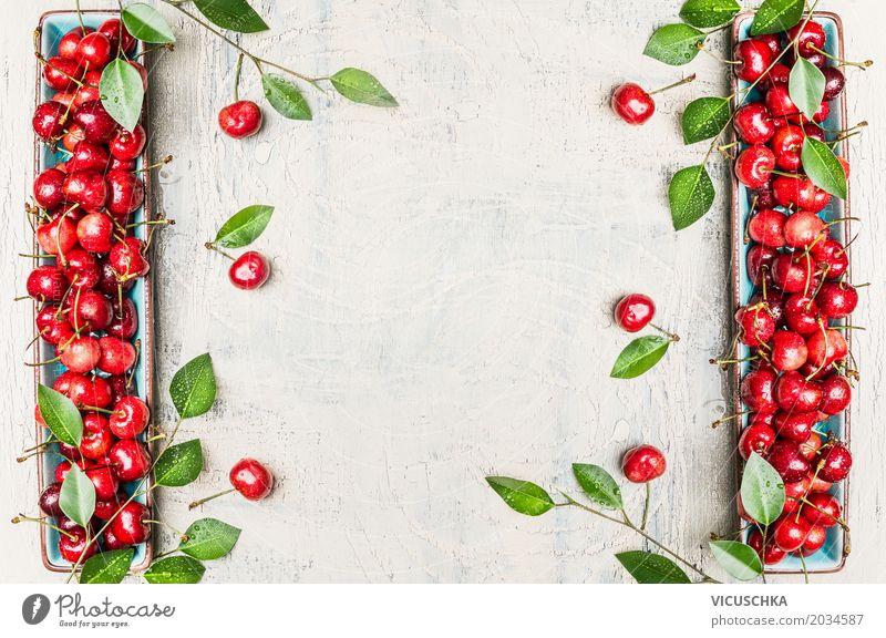 Hintergrund mit roten Kirschen und grünen Blättern Lebensmittel Frucht Ernährung Bioprodukte Vegetarische Ernährung Diät Stil Design Gesundheit