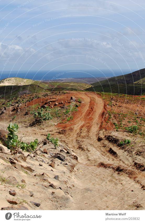 der Weg reloaded Natur Ferien & Urlaub & Reisen Meer Landschaft Wolken Ferne Freiheit Sand Horizont frei Ausflug Spuren Fußweg Afrika Ödland Reifenspuren