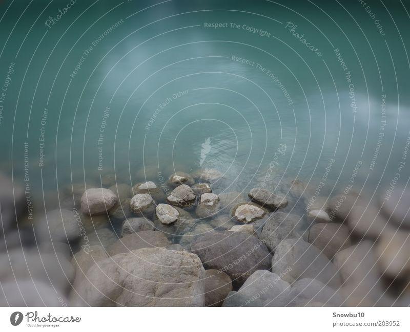 Stones Natur Wasser ruhig Erholung Gefühle Stein See Landschaft Stimmung Kraft nass Seeufer steinig Unschärfe