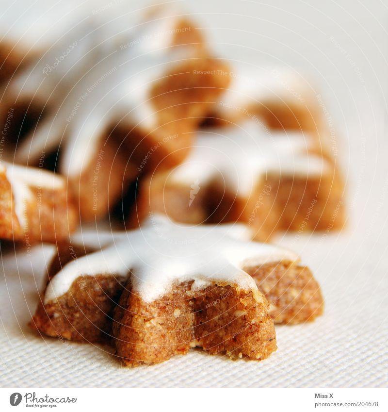 Out of season Weihnachten & Advent Ernährung Lebensmittel süß lecker Süßwaren Backwaren Zucker Teigwaren Plätzchen Zimt Zuckerguß Klebrig Zimtstern