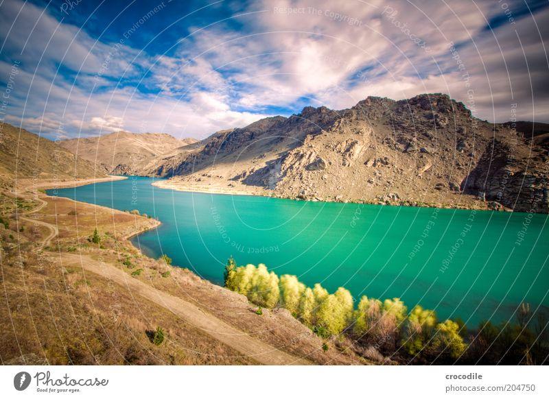New Zealand 80 Natur blau Berge u. Gebirge Wege & Pfade See Landschaft Umwelt Felsen ästhetisch Hügel Urelemente Schönes Wetter Weitwinkel Gebirgssee Wolkenhimmel
