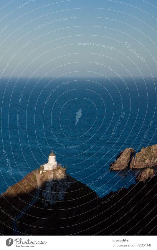 New Zealand 118 Umwelt Natur Landschaft Urelemente Wasser Wolkenloser Himmel Horizont Schönes Wetter Felsen Riff Meer Pazifik Insel Nugget Point Leuchtturm