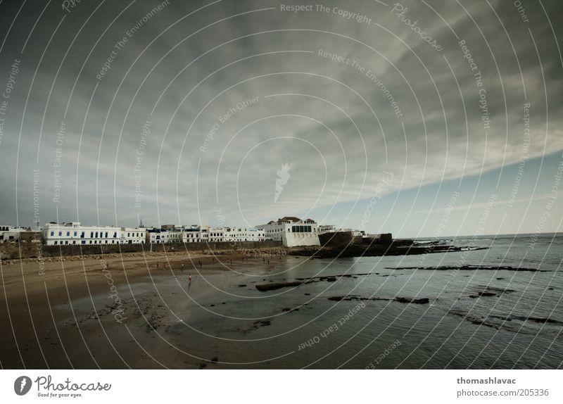 Wasser Himmel Meer Strand Ferien & Urlaub & Reisen Wolken Wellen Küste Umwelt Afrika Dorf Atlantik Altstadt Marokko Sonnenaufgang Weitwinkel