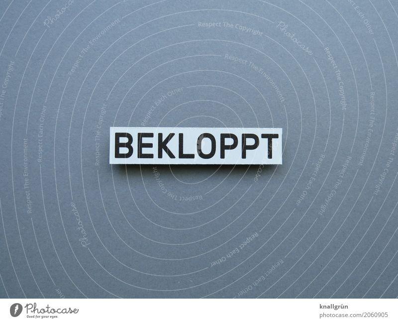 BEKLOPPT Schriftzeichen Schilder & Markierungen Kommunizieren eckig grau schwarz weiß Gefühle Stimmung dumm doof Schimpfwort abfällig schimpfen Farbfoto