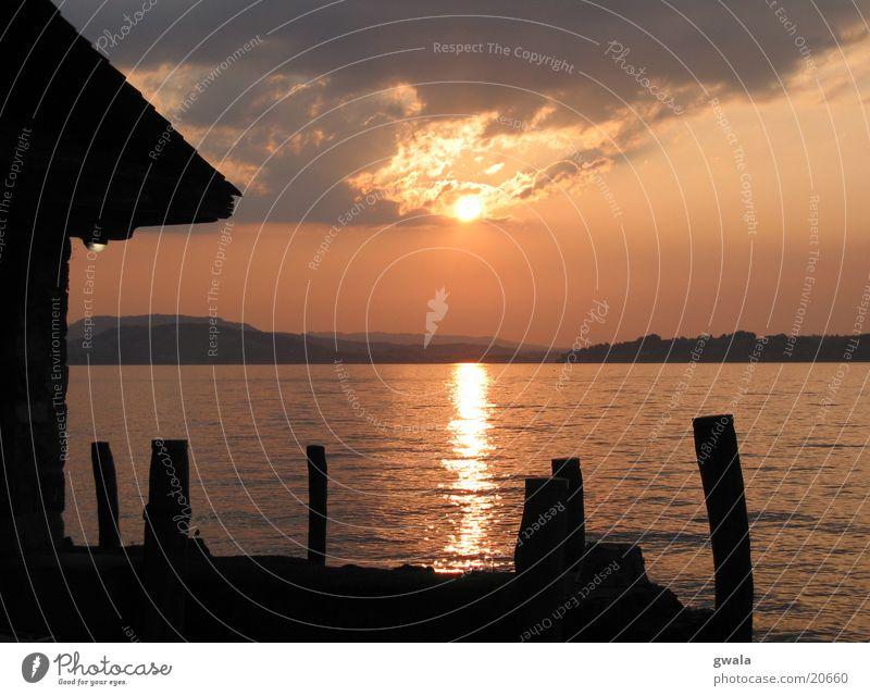 sunsetsteg Wasser orange Steg Abendsonne Vierwaldstätter See