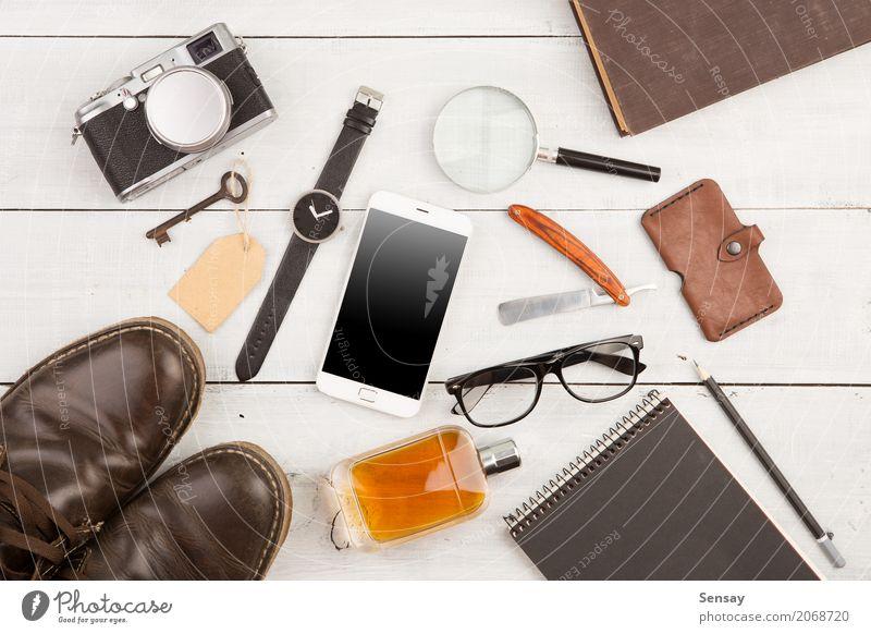 Reisekonzept Ferien & Urlaub & Reisen Schreibtisch Tisch Büro Telefon Fotokamera Mann Erwachsene Mode Leder Accessoire Schuhe Stiefel Rudel Schreibstift