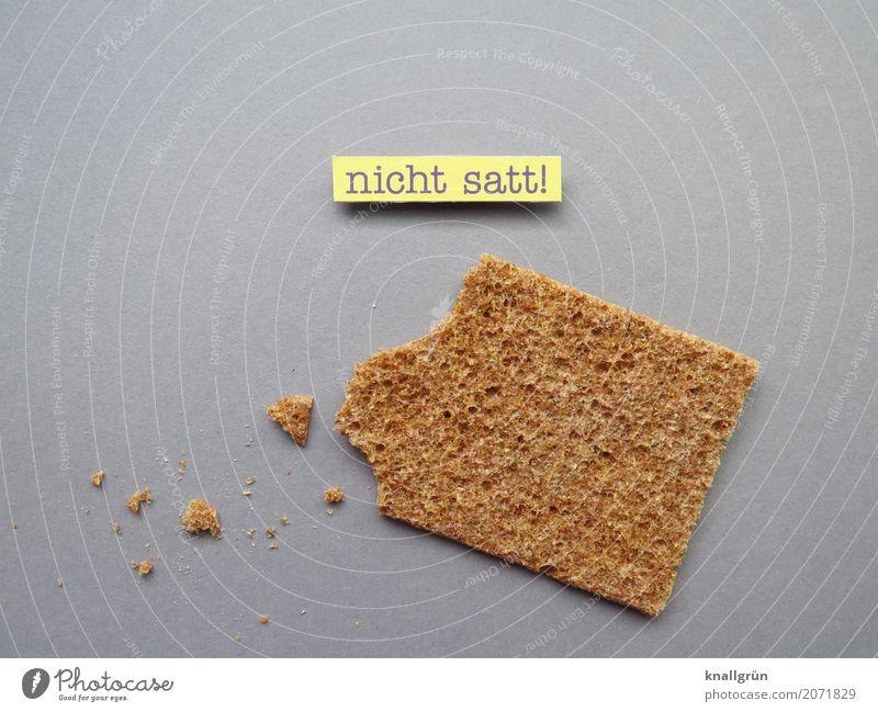 nicht satt! gelb Gefühle Lebensmittel grau braun Ernährung Schriftzeichen Kommunizieren Schilder & Markierungen Armut dünn Getreide Reichtum Appetit & Hunger