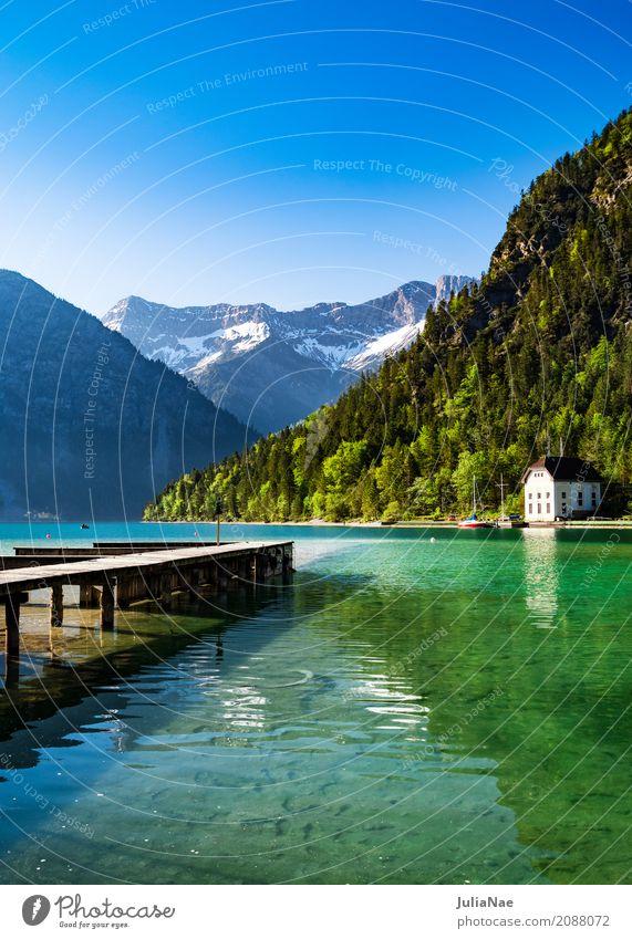 See mit Steg und Bergen im Hintergrund Erholung ruhig Ferien & Urlaub & Reisen Schnee Berge u. Gebirge Natur Landschaft Wasser Himmel Wolkenloser Himmel
