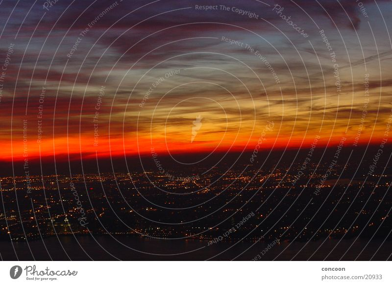 New York City Sunset Sonnenuntergang Stadt USA Licht Roter Himmel Wolkenhimmel Vogelperspektive Überblick Aussicht beeindruckend Skyline erleuchten Stadtlicht