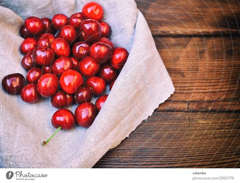 Reife rote Kirsche Frucht Dessert Vegetarische Ernährung Sommer Garten Tisch Natur Holz frisch natürlich oben retro saftig gelb Hintergrund Beeren Lebensmittel