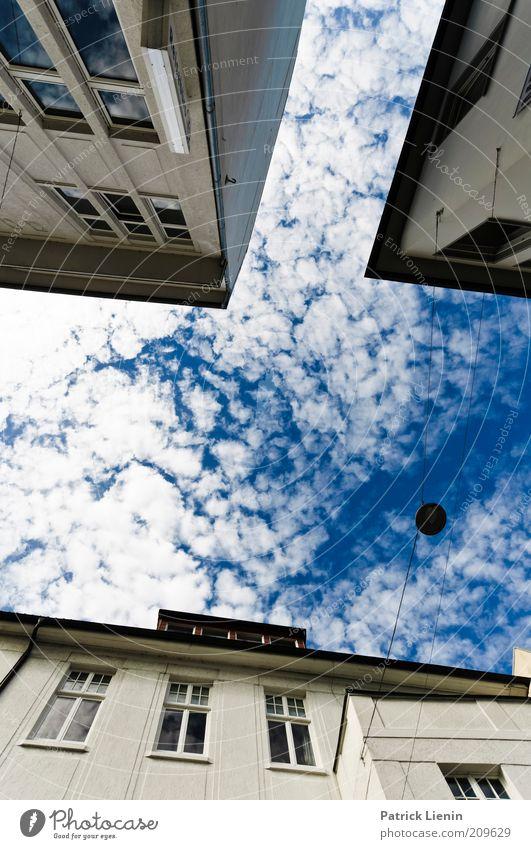 look in the sky Umwelt Luft Wolken Sommer Klima Klimawandel Haus Bauwerk Gebäude Architektur Fenster Blick Stimmung blau oben Ferne Verzerrung Farbfoto
