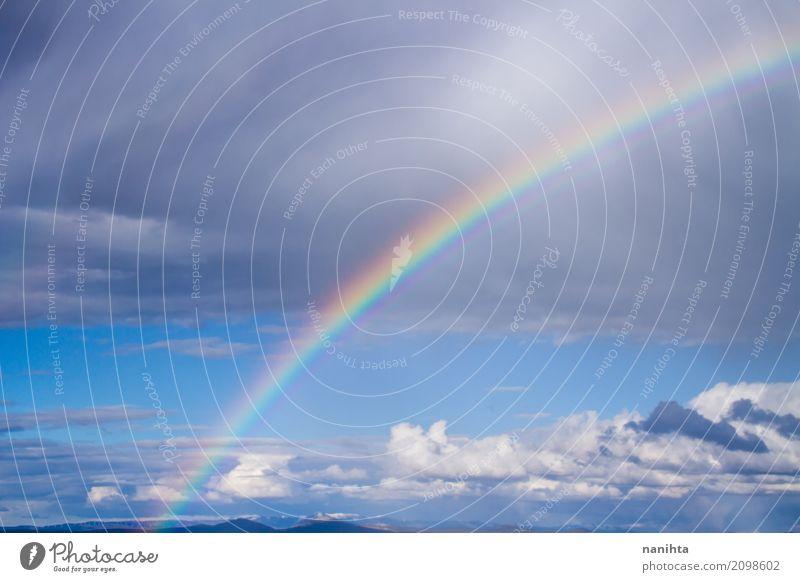 Schöner Regenbogen Umwelt Natur Luft Wassertropfen Himmel Wolken Gewitterwolken Frühling Sommer Klima Wetter Schönes Wetter authentisch fantastisch Fröhlichkeit