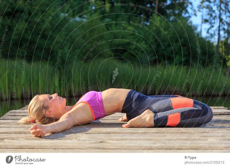 A sporty woman doing yoga and stretching exercises Lifestyle Wellness Sport Yoga Mensch Frau Erwachsene 30-45 Jahre Natur Park Mode blond Fitness Aerobics
