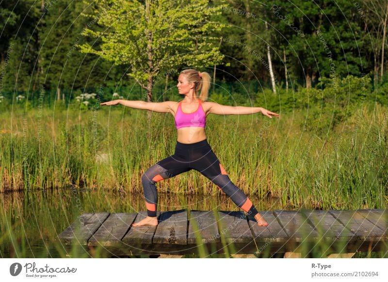 A sporty woman doing yoga and stretching exercises Lifestyle Wellness Sport Yoga Mensch Frau Erwachsene Natur Park Mode blond Fitness Aerobics active athlete