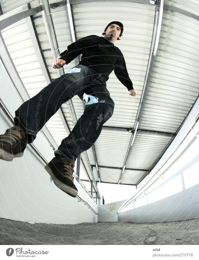 Punktlandung – 200 Lifestyle Mensch maskulin Junger Mann Jugendliche Erwachsene 1 18-30 Jahre Bahnhof Parkhaus Architektur Mauer Wand Rampe Bekleidung Jeanshose