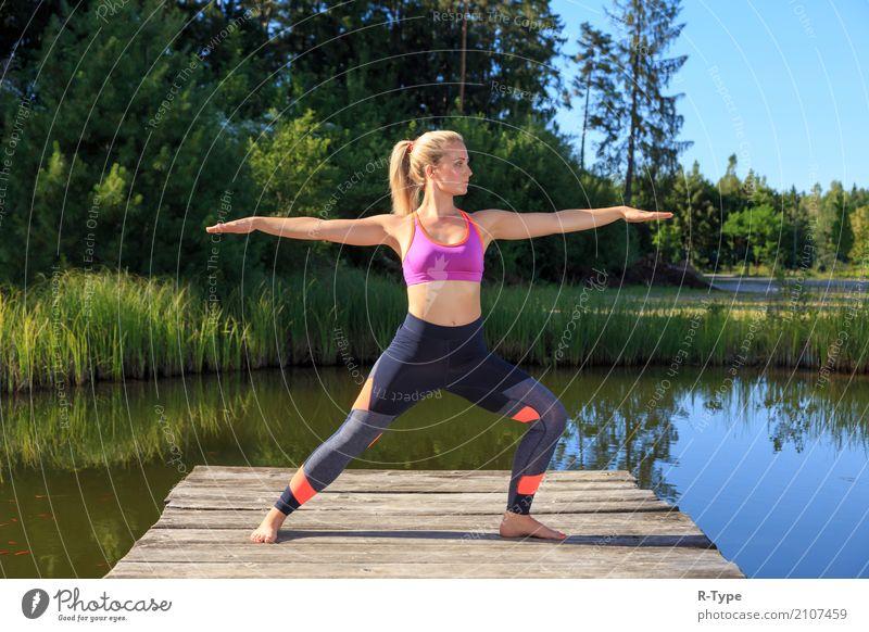 A sporty woman doing yoga and stretching exercises Mensch Frau Natur Erwachsene Lifestyle Sport Mode Park blond Fitness Wellness Körperhaltung Model Yoga Dock