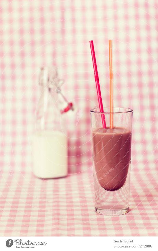Schoko Lebensmittel Milcherzeugnisse Getränk Kakao Flasche Glas Trinkhalm lecker süß Milchflasche Vollmilch Foodfotografie schokobraun Schokomilchshake Farbfoto