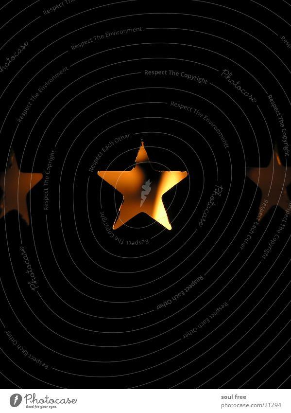 Weihnachtliches Teelicht Licht Kerze Kerzenständer dunkel Makroaufnahme Nahaufnahme Stern (Symbol) Weihnachten & Advent Brand