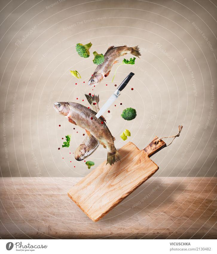 Fisch mit Schneidebrett und Messer Gesunde Ernährung Foodfotografie Stil Lebensmittel Design Tisch Kräuter & Gewürze Küche Gemüse Bioprodukte Geschirr fliegend
