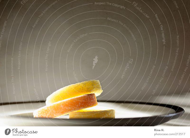 Lichtes Süsses Ernährung gelb hell gold süß leuchten lecker Süßwaren genießen Teller erleuchten Geschirr Foodfotografie