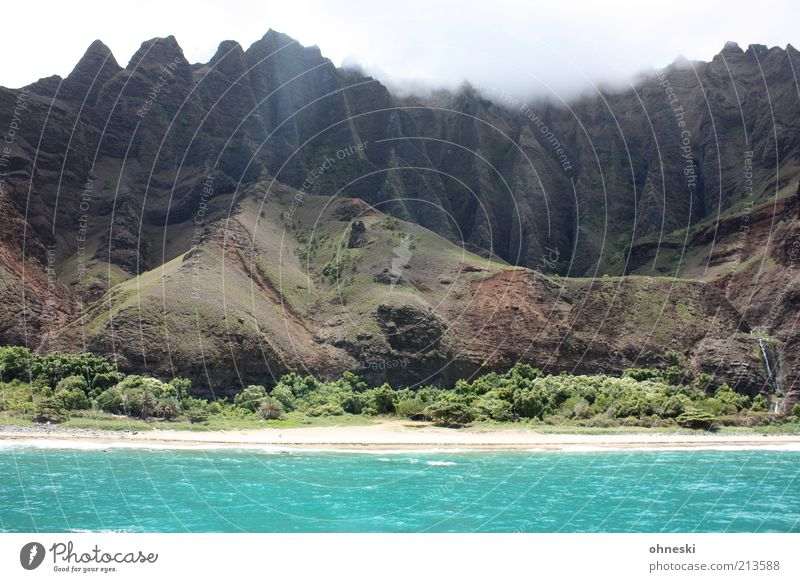 Na Pali Coast II Wasser Himmel Meer Strand Berge u. Gebirge Stein Landschaft Kraft Küste Wellen Felsen Erde Insel Sträucher wild Hügel