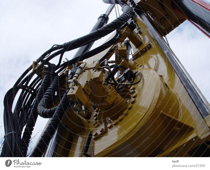 Hydraulikschläuche Maschine Stahl Schraube gelb Baumaschine Elektrisches Gerät Technik & Technologie hydraulisch Nahaufnahme Kabel Baustelle