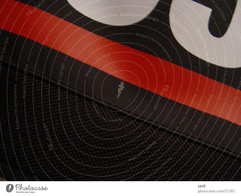 redline Stoff Typographie dunkel rot Makroaufnahme Nahaufnahme Detailaufnahme