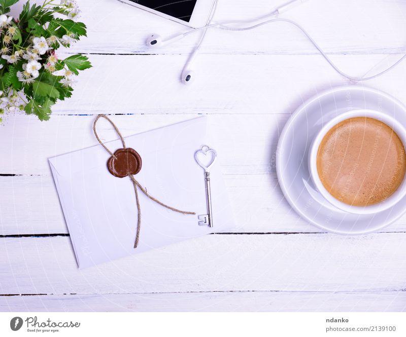 Tasse Kaffee Frühstück Kaffeetrinken Heißgetränk Becher Telefon PDA Blume Blühend Essen oben Kuvert Siegel Taste Blütenknospen Top Kopfhörer Farbfoto