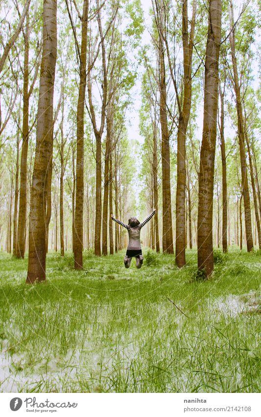 Junge Frau, die mitten in einem Wald springt Wellness Leben Ferien & Urlaub & Reisen Abenteuer Ferne Freiheit Expedition Mensch feminin Jugendliche 1