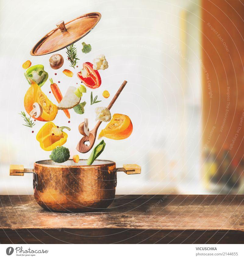Kochtopf mit fliegendes Gemüse und Kochlöffel Lebensmittel Suppe Eintopf Kräuter & Gewürze Ernährung Mittagessen Bioprodukte Vegetarische Ernährung Diät