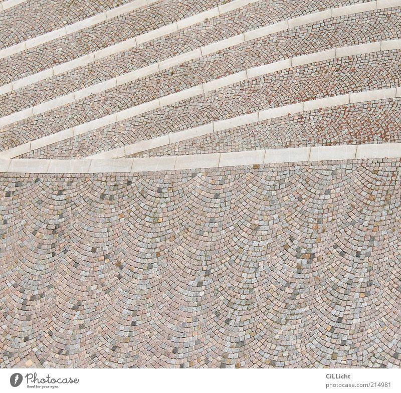 Wellen weiß grau Stein Linie braun Erde ästhetisch Platz einfach Pflastersteine geschwungen
