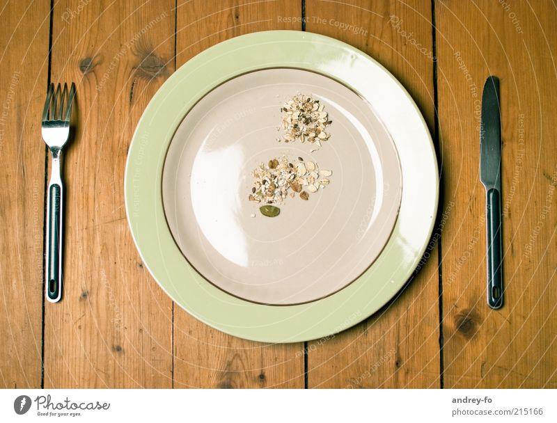 Hunger? Gesundheit Leben Gastronomie Schalen & Schüsseln Teller Holz braun Appetit & Hunger Armut Tellerrand Geschirr Gabel Messer Müsli Tisch Ernährung