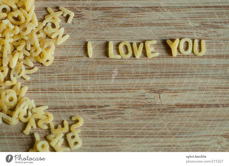 I love You gelb Liebe Gefühle sprechen Holz klein Lebensmittel braun Schriftzeichen Ernährung Romantik Küche schreiben Verliebtheit Backwaren Teigwaren