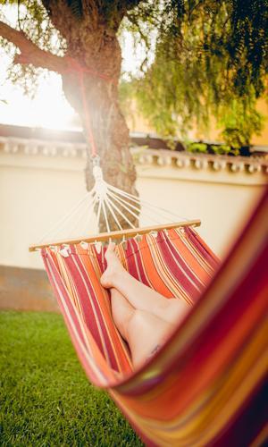Girl is relaxing in a hammock Lifestyle schön Gesundheit Wellness harmonisch Wohlgefühl Zufriedenheit Erholung ruhig Ferien & Urlaub & Reisen Sommer