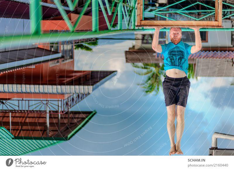 Turned upside down picture: yoga teacher portrait. Red hair man with a red beard showing headstand. Lifestyle Erholung Meditation Sport Yoga Erwachsene sitzen