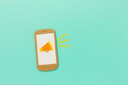 Alert. Megafon Symbol auf Handy-Display. PDA Internet Neue Medien Kommunizieren sprechen außergewöhnlich modern türkis Macht Netzwerk Neugier Marketing Megaphon