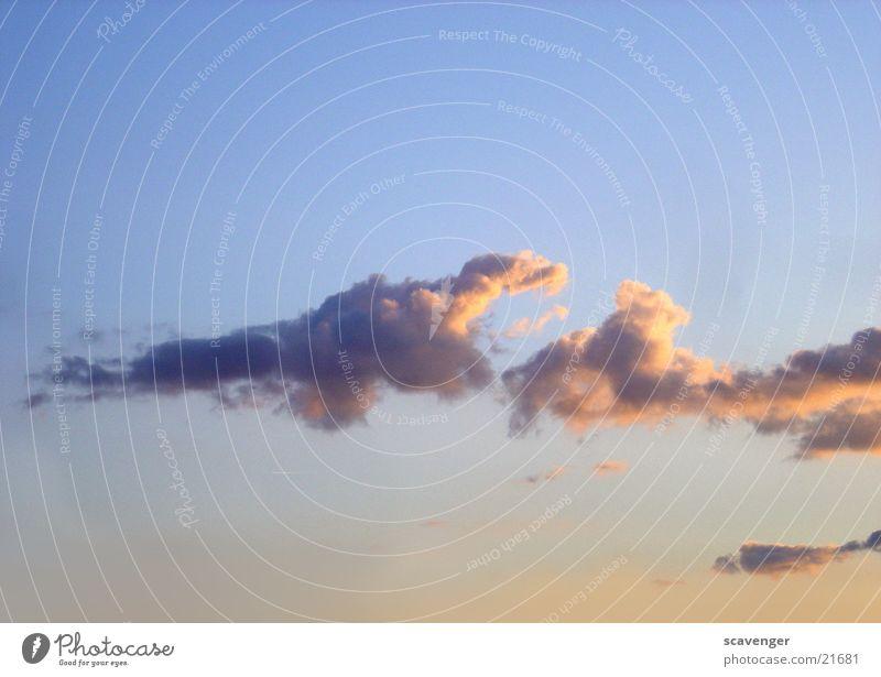 sunset clouds Sonne blau rot Wolken gelb Beleuchtung Abenddämmerung
