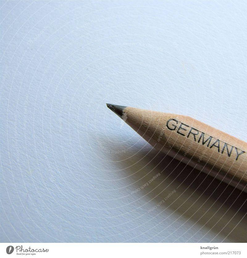 Made in Germany Bleistift Schreibstift Schriftzeichen Spitze braun grau weiß Inspiration Qualität Wert angespitzt Schreibgerät zeichnen Farbfoto Gedeckte Farben